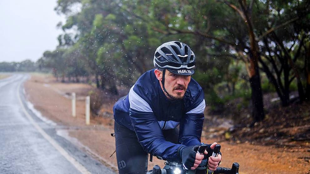 Mike Hall powers through the rain during Day 2 of the Indian Pacific Wheel Race. Image: Rapha Australia / IPWR