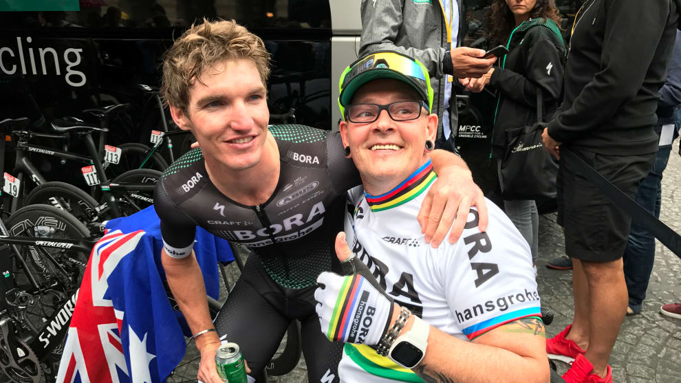 Jay McCarthy with a Bora-hansgrohe fan at the finish of the 2017 Tour de France in Paris. Image: Nat Bromhead.