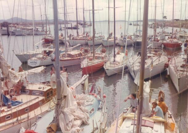 Cinda Lee at the raft-up at Gladstone, 1974. Helsal next to wharf (far right), then Love & War, Vanessa, Cinda Lee (red hull), Zilver Meeuw, Wistari (stern to) and Starr Bay.