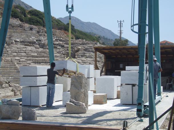 Masons cutting new stone for reconstruction at Knidos.