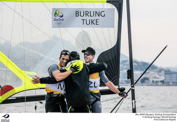 The Kiwis celebrate their Gold medal with their coach. Photo Sailing Energy/World Sailing.