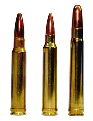 .300 Winchester Magnum (center) flanked by its parent cartridges: the .338 Winchester Magnum (left) and the .375 H&H Magnum (right).