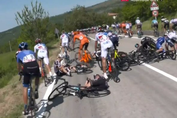 Numerous riders came down in the mass pileup caused by a police moto parked on the side of the road. Image: GranFondoGFNCS / Twitter.