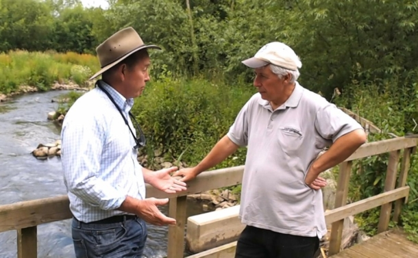 Martin Salter (right) proudly showing off a new fish pass and habitat enhancement project to Craig Copeland on his local River Loddon.