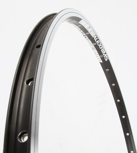 You can see the single eyelets in this rim, fixed to only the inner wall. These reinforce the spoke hole to prevent cracking around the nipple, help to prevent the nipple pulling through and also allow the nipple to turn more easily while building.