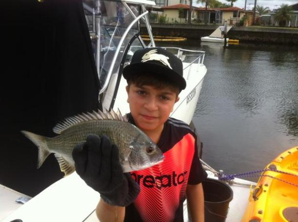 Keen young fisho Phillip Satici has been busy catching various fish in Botany Bay, including this nice bream.