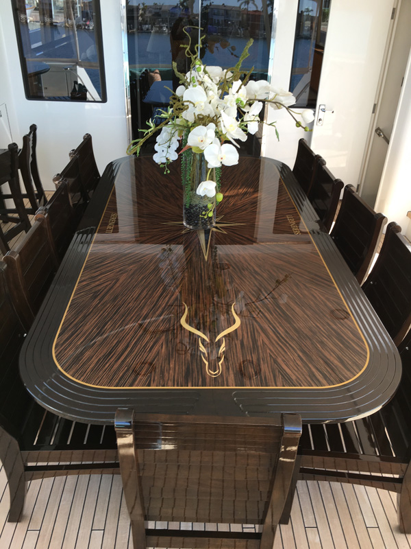 Gavin Harrington, Serengity dining table and chairs in wenge with cherry banding and marquetry motif.