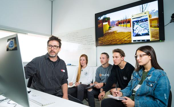 TAFE SA Principal Lecturer in Creative Studies Mark Wilson with screen and media students. Credit: Juan Photography 2013