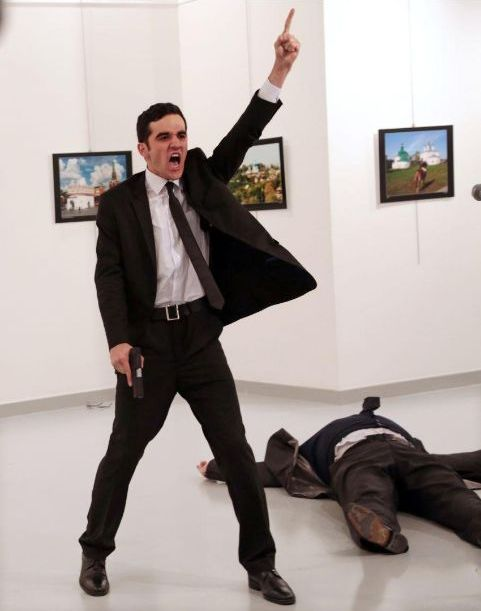 Mevlüt Mert Altıntaş, a 22-year-old off-duty police officer, is photographed moments after assassinating Andrey Karlov, the Russian ambassador to Turkey, at an art gallery in Ankara, Turkey, on 19 December 2016. He wounded three other people before being killed by officers in a shootout. Photo © Burhan Ozbilici, Turkey, The Associated Press, 2017 World Press Photo of the Year, First Prize Singles.