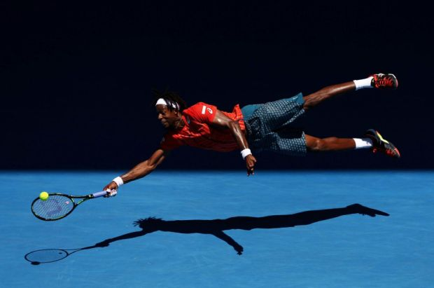 The Dive. Gaël Monfils of France dives for a forehand in his fourth round match against Andrey Kuznetsov of Russia, during the 2016 Australian Open at Melbourne Park, Australia, on 25 January 2016. Photo © Cameron Spencer, Australia, Getty Images, Sports second prize singles.
