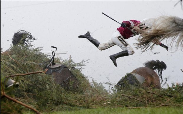Jockey Nina Carberry flies off her horse, Sir Des Champs, as they fall at The Chair fence during the Grand National steeplechase, during day three of the Grand National Meeting at Aintree Racecourse on 9 April 2016 in Liverpool, England. Photo © Tom Jenkins, UK, The Guardian, Sports, First Prize, Singles.