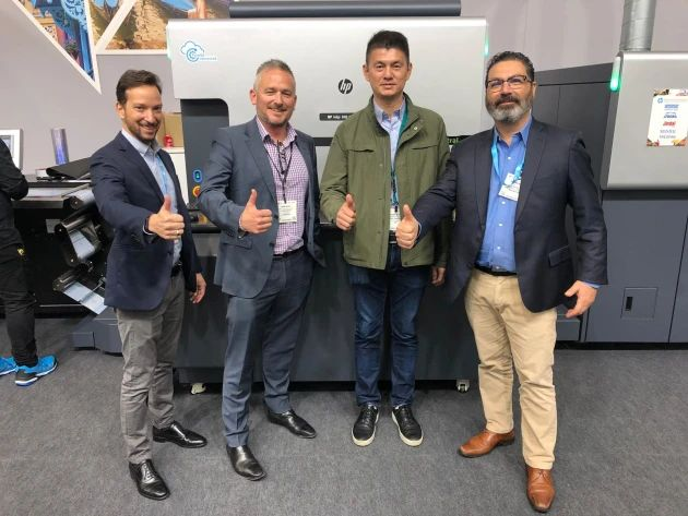 Next into labels: Romeo Sanuri (2nd right) at Labelexpo with (l-r) Yoav Lotan, HP; Mark Daws, Currie Group; and Rafael Kraus, HP.