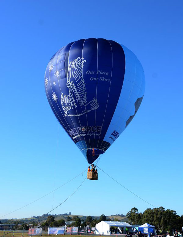 With virtually no wind on the Sunday morning, the RAAF was offering tethered balloon rides to the general public. (Steve Hitchen)