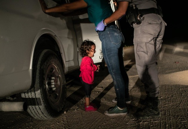 World Press Photo of the Year Nominee. Crying Girl on the Border. Yana, from Honduras, cries as her mother Sandra Sanchez is searched by a US Border Patrol agent, in McAllen, Texas, USA, on 12 June. © John Moore, Getty Images.
