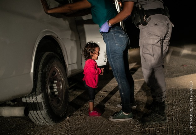 Crying Girl on the Border. Yana, from Honduras, cries as her mother Sandra Sanchez is searched by a US Border Patrol agent, in McAllen, Texas, USA, on 12 June. © John Moore, Getty Images