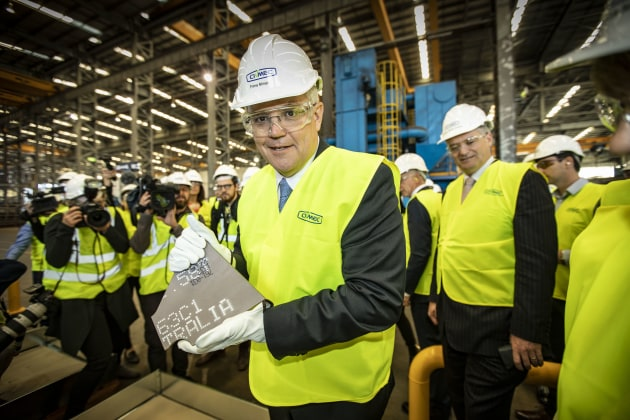 PM Scott Morrison with the first steel for the OPVs. Civmec