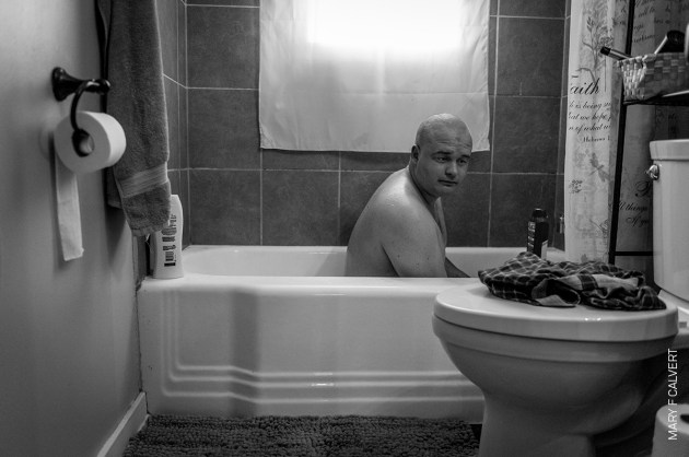 Male Rape. Former US marine Ethan Hanson bathes at home in Austin, Minnesota, USA, after a sexual trauma experienced during his military service left him unable to take showers. © Mary F. Calvert