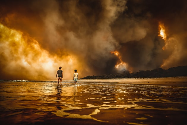 © Martin Von Stoll. Beauty and the Beast. Winner of the Single Shot category of Australasia's Top Emerging Photographers 2020. Captured at Black Head Beach during the NSW bushfires in later 2019.