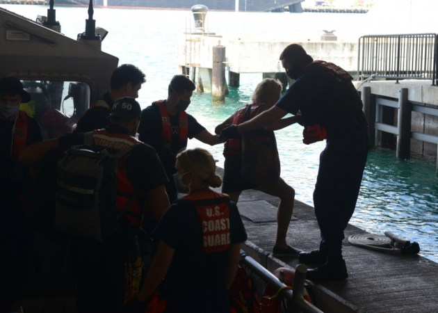 Rescued crew comes ashore. Photo by Petty Officer 3rd Class Matthew West.