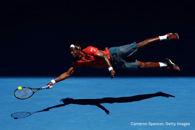 Sports - Second Prize, Singles Gaël Monfils of France dives for a forehand in his fourth round match against Andrey Kuznetsov of Russia, during the 2016 Australian Open at Melbourne Park, Australia, on 25 January 2016. The Australian Open holds the record for the highest attendance at a Grand Slam event. © Cameron Spencer, Getty Images.