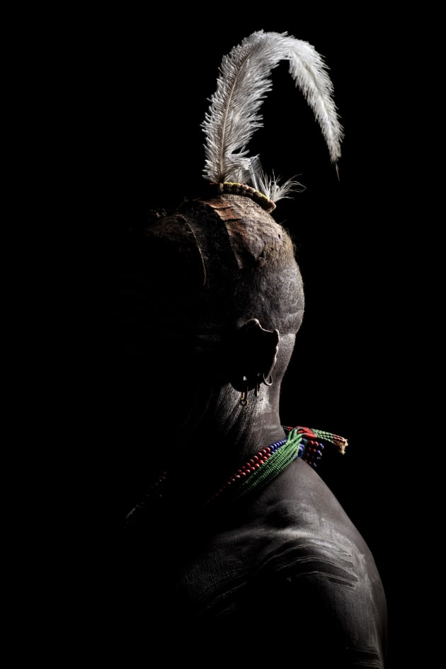 © Ben McRae, Australia. Highly Commended – People & Cultures portfolio. Dus Village, Omo Valley, Ethiopia. All Kara have their own style of face and body painting. These intricate dots or drawn lines on a body represent the plumage of the guinea fowl.