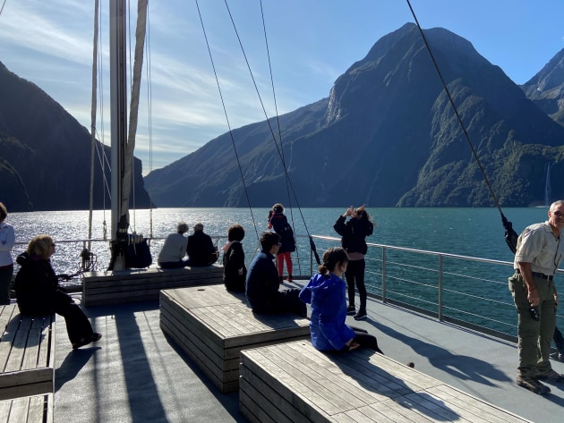 Our group enjoying the sites of Milford Sound out on deck.