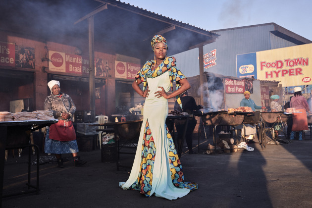 © Lee-Ann Olwage. Black Drag Magic - Portrait of a Drag Artist and Activist. Belinda Qaqamba Ka-Fassie, a drag artist and activist, poses at a shisanyama—a community space where women cook and sell meat—in Khayelitsha, a township located on the Cape Flats, near Cape Town, South Africa, on 4 August 2019.