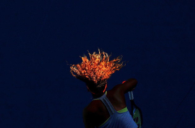 World Press Photo Sports - Singles nominee. Sunlight Serve © David Gray, Reuters. Naomi Osaka serves during her match against Simona Halep from Romania during the Australian Open tennis tournament, at Margaret Court Arena, Melbourne, Australia, on 22 January.