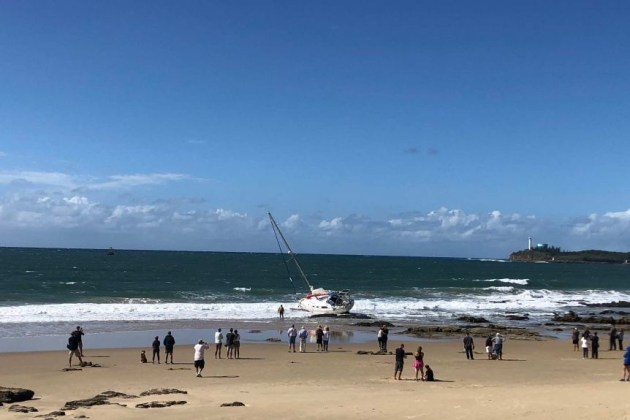 An empty yacht washed up on Mooloolaba Beach overnight.(ABC News: Owen Jacques)