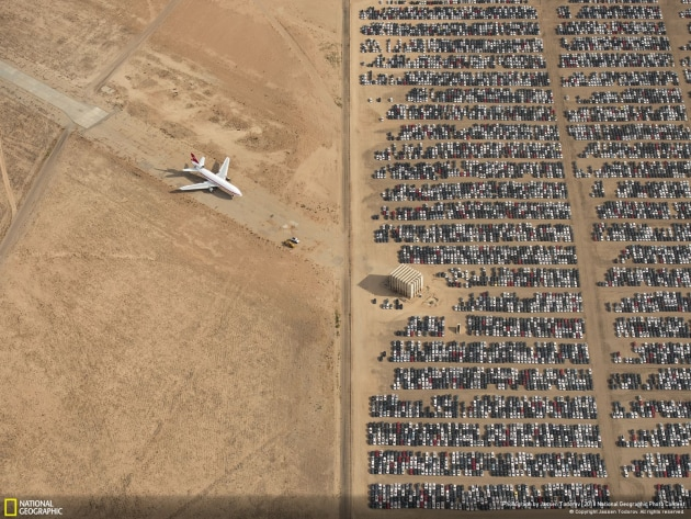 Thousands of Volkswagen and Audi cars sit idle in the middle of California's Mojave Desert. Models manufactured from 2009 to 2015 were designed to cheat emissions tests mandated by the U.S. Environmental Protection Agency. Following the scandal, Volkswagen recalled millions of cars. By capturing scenes like this one, I hope we will all become more conscious of and more caring toward our beautiful planet.