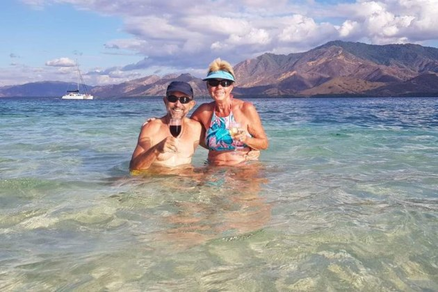 Queenslanders Craig and Del McEwan have been travelling the world via catamaran.(Supplied)