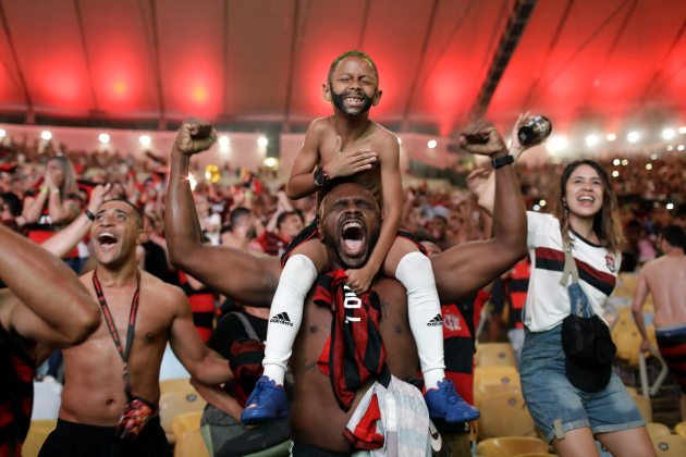 © Silvia Izquierdo, Associated Press. Cheering the Goal. Fans of Brazil's Flamengo football team cheer as Gabriel Barbosa scores a goal against defending champions River Plate of Argentina, in the final of the Copa Libertadores, broadcast on giant screens during a watch party at Maracanã Stadium in Rio de Janeiro, Brazil, on 23 November 2019.