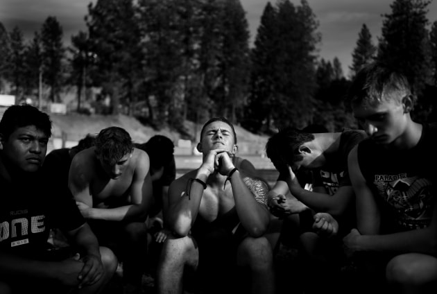© Wally Skalij, Los Angeles Times. Rise from the Ashes. Lukas Hartley (center) listens to a Paradise Bobcats coach give a pep talk on 22 August 2019, before their first game of the season since Camp Fire devastated their town.