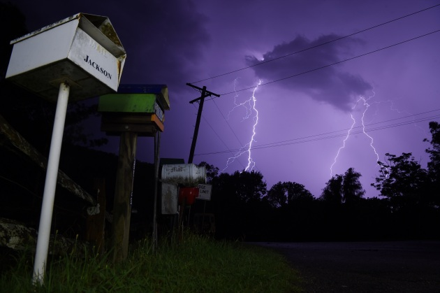 © Nick Moir. Lightning strikes near Laguna to the north of Sydney, known for its long lines of often quirky letterboxes. January, 2017.