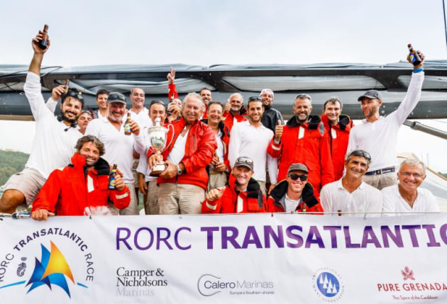 Celebrations in Grenada: Clutching the magnificent International Maxi Association Transatlantic Trophy for Monohull Line Honours, Pier Luigi Loro Piana, whose Baltic 130 My Song has also set a new monohull race record © RORC/Arthur Daniel.