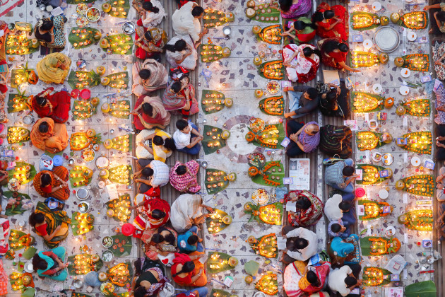 Overall Winner: Pink Lady® Food Photographer of the Year: Noor Ahmed Gelal, Bangladesh. Praying with Food. Breaking the fast in congregation. A section of the Hindu community is preparing to break the day-long fast in one of the local temples at Swamibag, Dhaka, Bangladesh. They believe their fasting will redeem their sins.