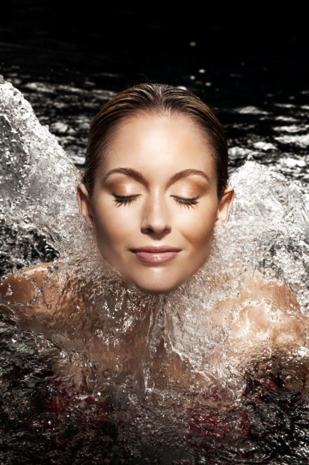 For beauty product, Liquid Lift, in black-bottomed pool, with a spot on model's face. © Michael Grecco.