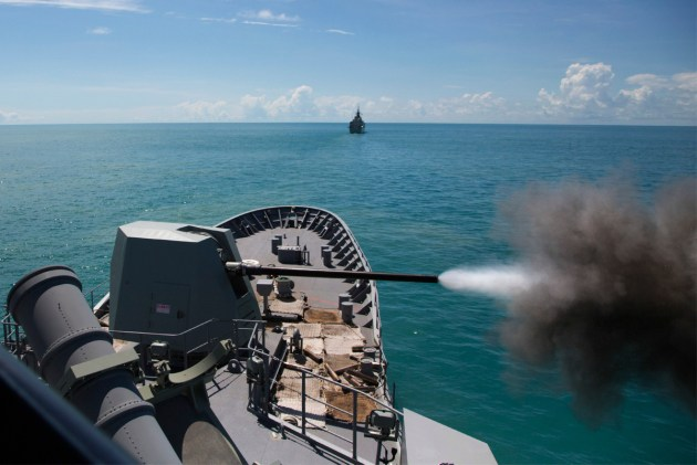 HMAS Warramunga fires her Mk 45 5 inch gun in the Northern Australian Exercise Area. C: Defence