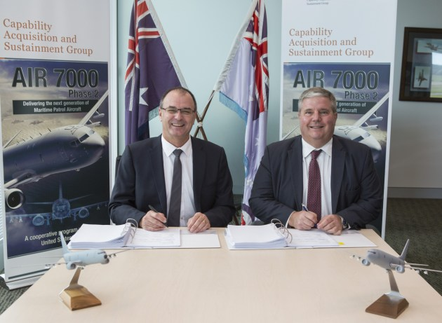 Tony Fraser, left, pictured in 2016 signing the P-8A contract. Defence