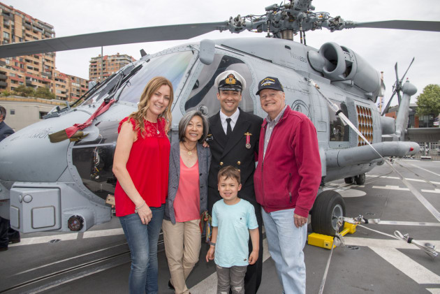Crew and family pose in front of the Warramunga's MH-60 Romeo Seahawk prior to departure from Fleet Base East on October 9. Credit: Defence