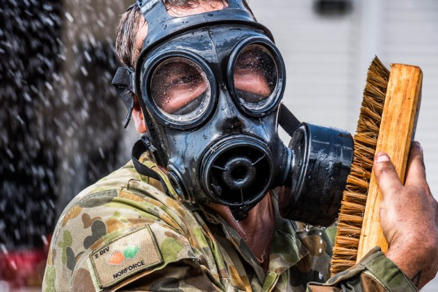 A trainee takes part in Chemical Biological Radiological Nuclear (CBRN) decontamination training at 1st Combat Engineer Regiment's out training facility. Image: Defence