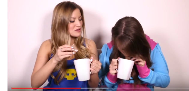 A Tim Tam slam is carried out on the iJustine YouTube channel.