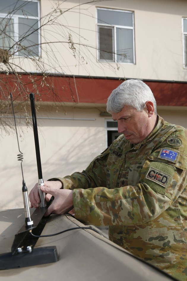 Army officer LTCOL Jason Medley prepares to install a Silvershield electronic force protection system, designed for the Afghan National Defence and Security Forces to counter radio-controlled improvised explosive devices. Credit: Defence