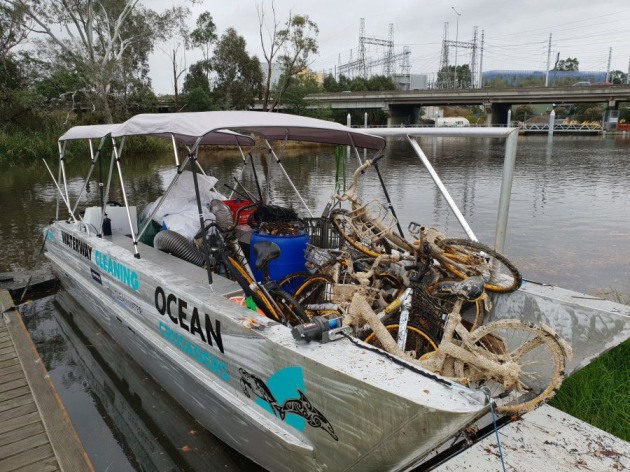 Ocean Crusaders barge with collected rubbish. Photo Ocean Crusaders.