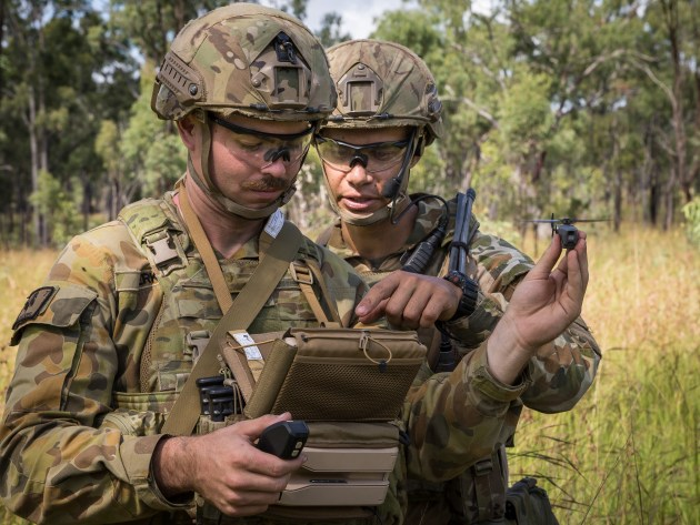 Australian Army soldiers Trooper Chris Perks (left) and Trooper Sam Menzies with a PD-100 Black Hornet Nano unmanned aircraft vehicle. Defence