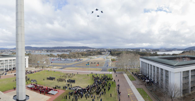 Four Royal Australian Air Force F/A-18 Hornets conduct a fly past during the change of command parade. Defence