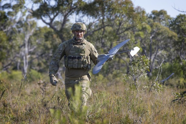 Lance Bombardier Jarrod Logan, retrieves the Wasp unmanned aerial system. Defence