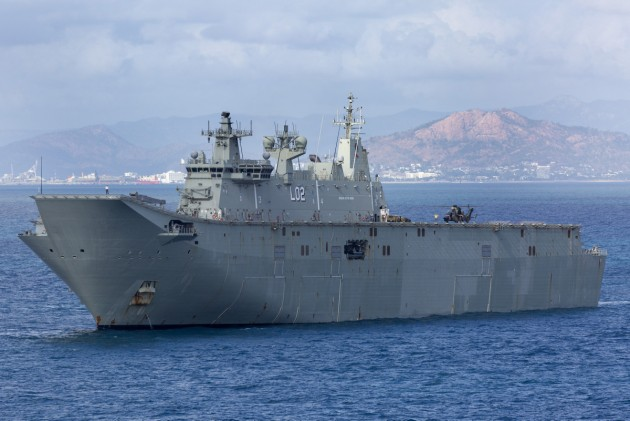 HMAS Canberra off the coast of Townsville. Defence