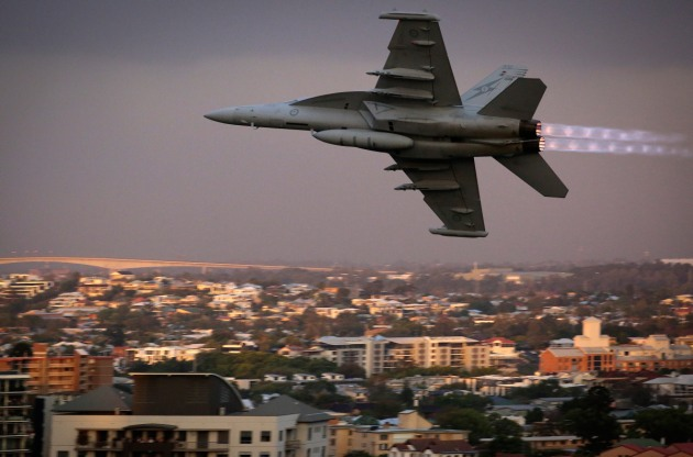A RAAF EA-18G Growler from No. 6 Squadron flies low above the Kangaroo Point area as part of a display for Brisbane's Sunsuper Riverfire. Credit: Defence