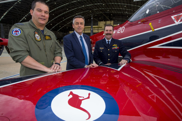 The Minister for Defence Personnel and Veterans' Affairs Darren Chester (centre), with Chief of Air Force, Air Marshal Leo Davies  (right) and Group Captain Dennis Tan, Officer Commanding Air Force Training Wing (left), during inspection of the new colour scheme of the PC-21 aircraft at Fairbairn.